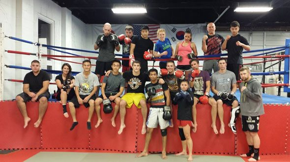 MMA Team in Boxing Ring